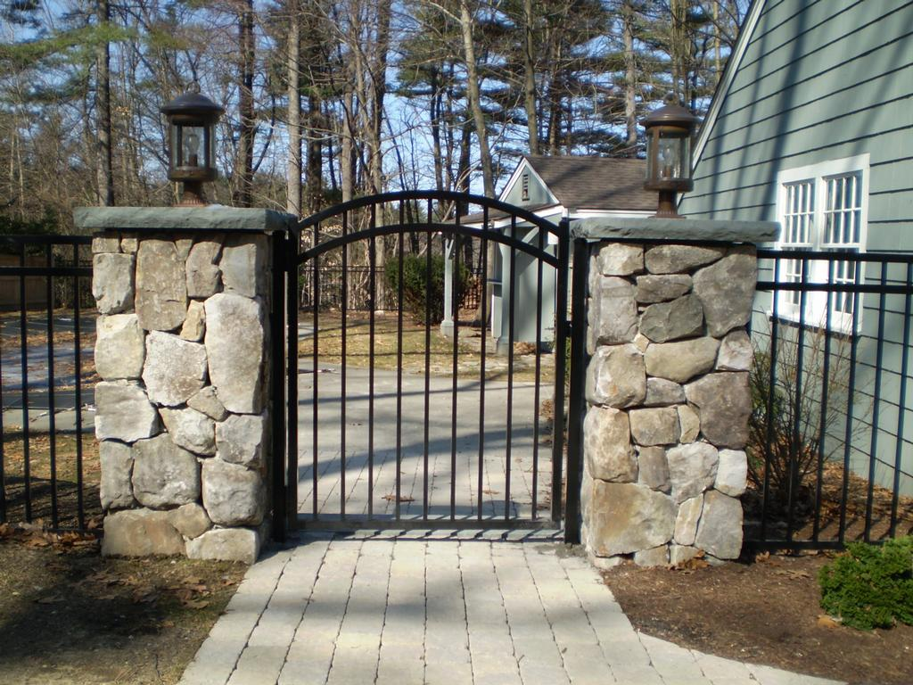 Wrought Iron Fence And Gate With Stone Columns Sudbury Cedar Fence