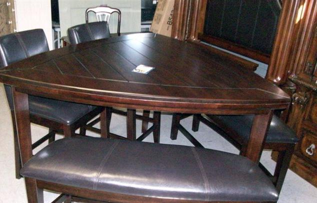 Triangle lakota dining table from hau furniture rental