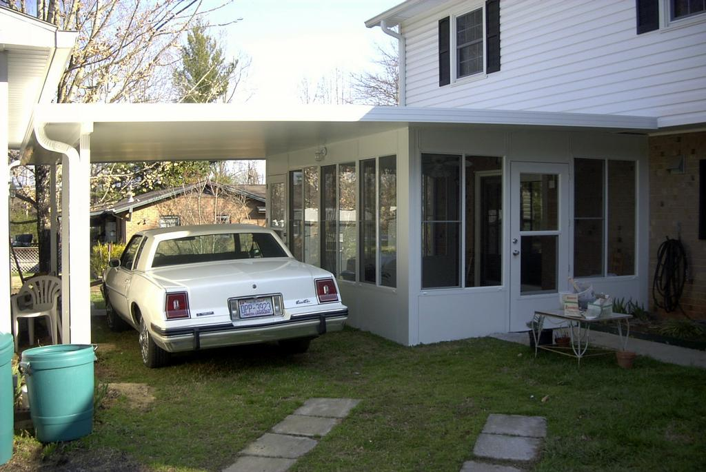 Insulated sunroom w attached carport from patios plus for Sunroom attached to house
