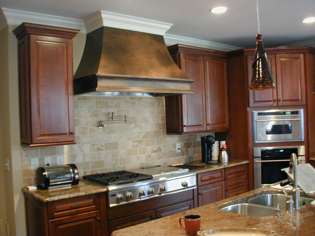KraftMaid Kitchen with Custom Hood from Cardinal Cabinetworks Inc