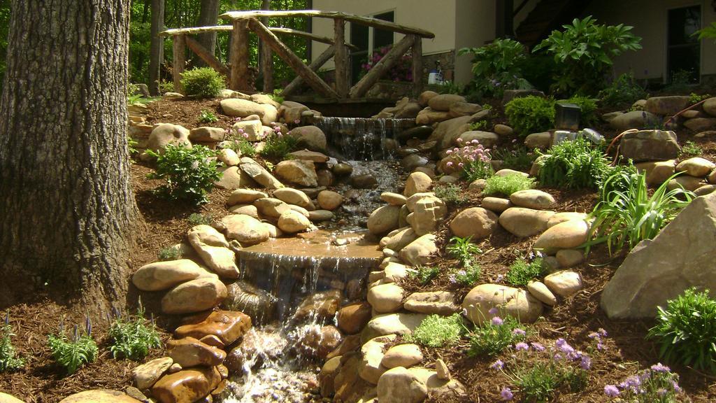 River Rock In Backyard : Waxhaw waterfall renovationJPG from Fine Edge Landscape Design in