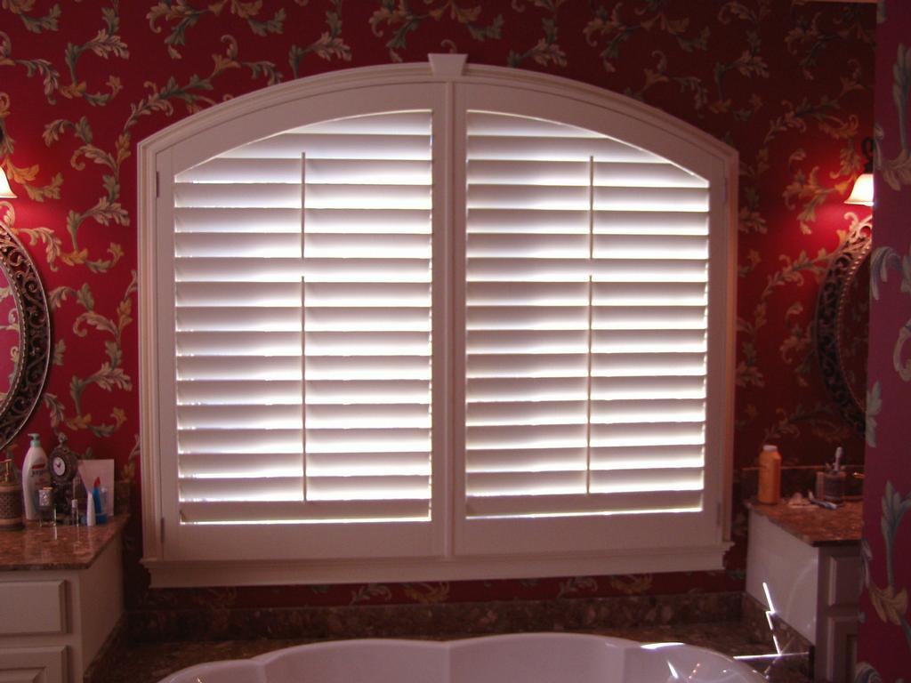 Arch shutters from aaa blinds and window fashions in for Motorized shades for arched windows