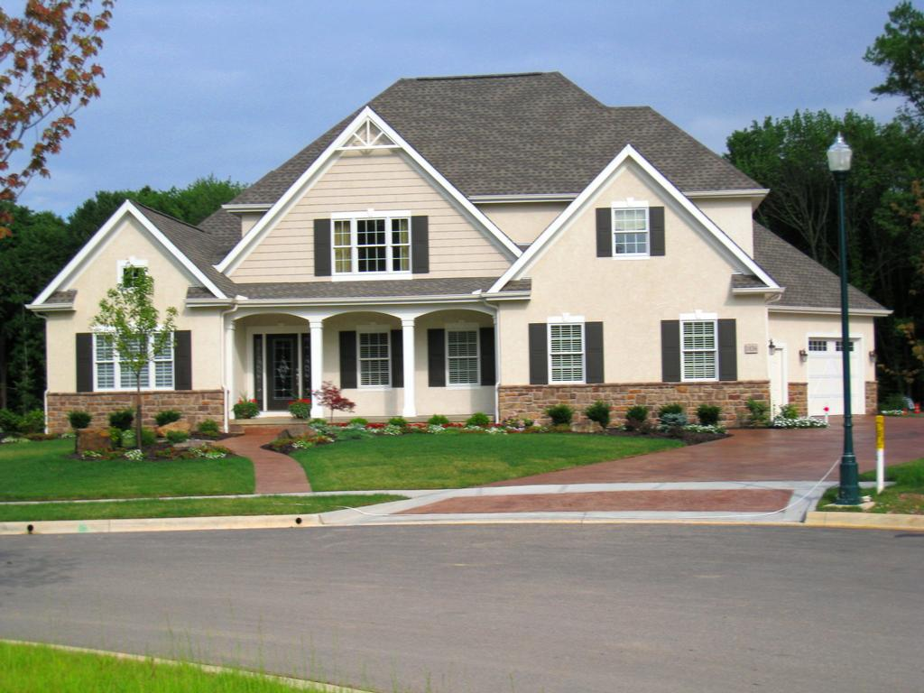 Stone stucco homes pictures lesbian arts for Stucco homes with stone