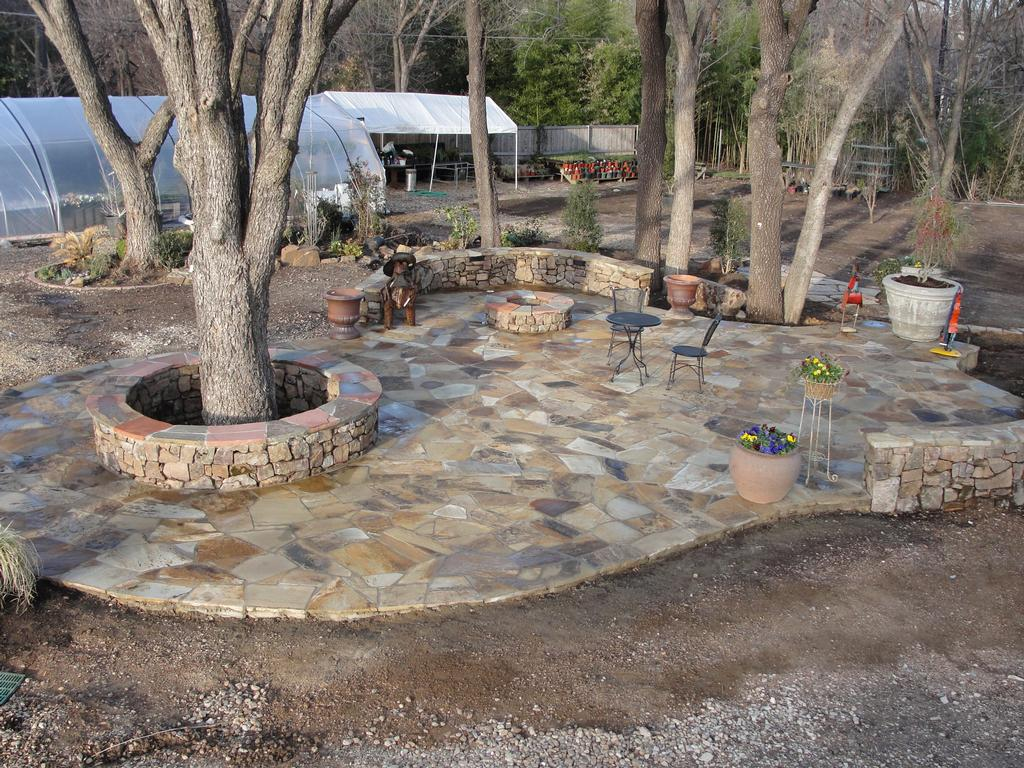 Stone patio at garden center from grow it land designs for Land design landscaping