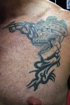 skull tattoo with crown. Tags: skull crown tribal black