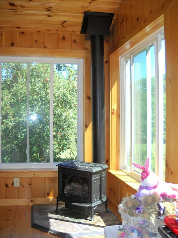 Jotul allagash gas stove in new hampshire sunroom from for Wood burning stove for screened porch