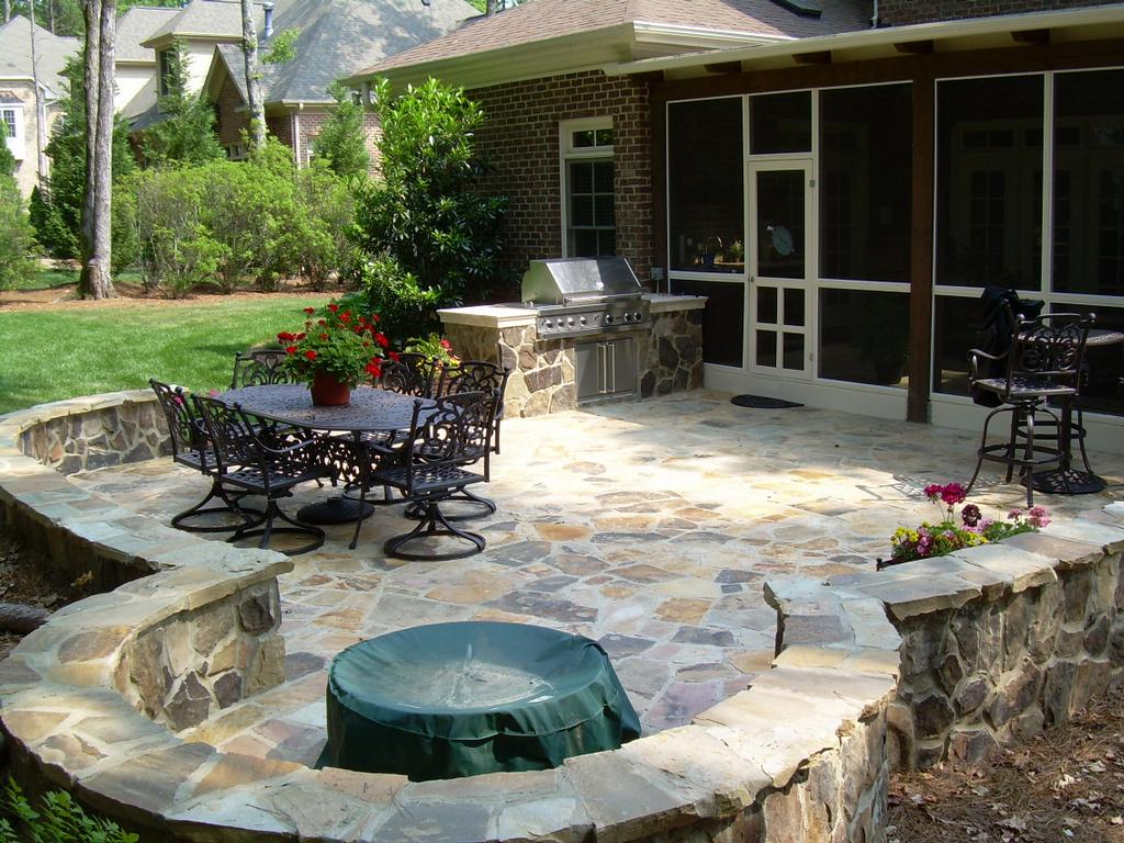 Great outdoors furnish your backyard with stone patios Backyard designs with gravel