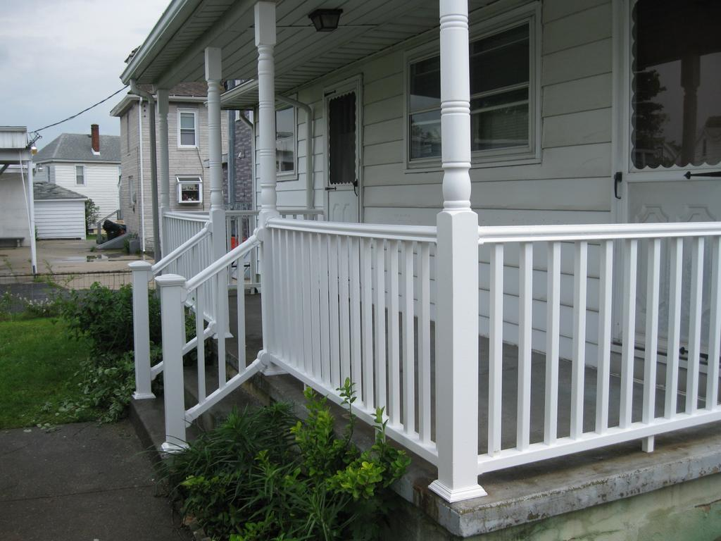 severe weather  posite porch railing from complete home