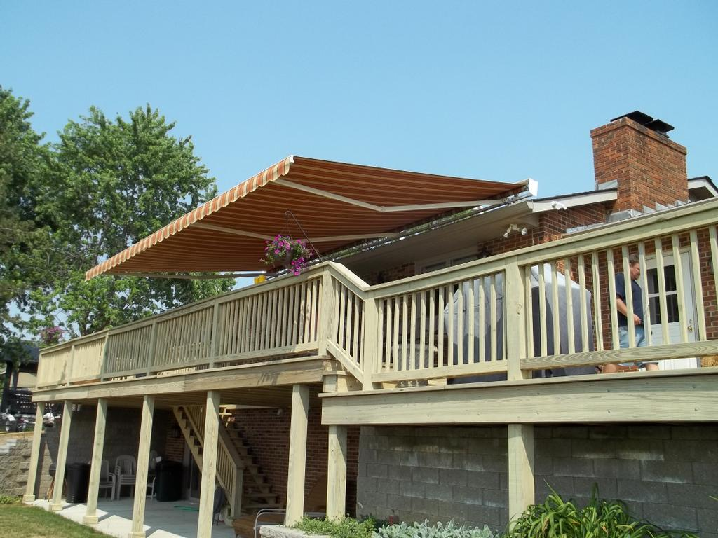 Roof mount oaktree retractable awning from shade by design for Roof awning design