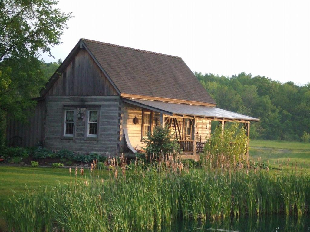 Summer log cabin by beside still waters greenhouse and log for Log cabin retreat