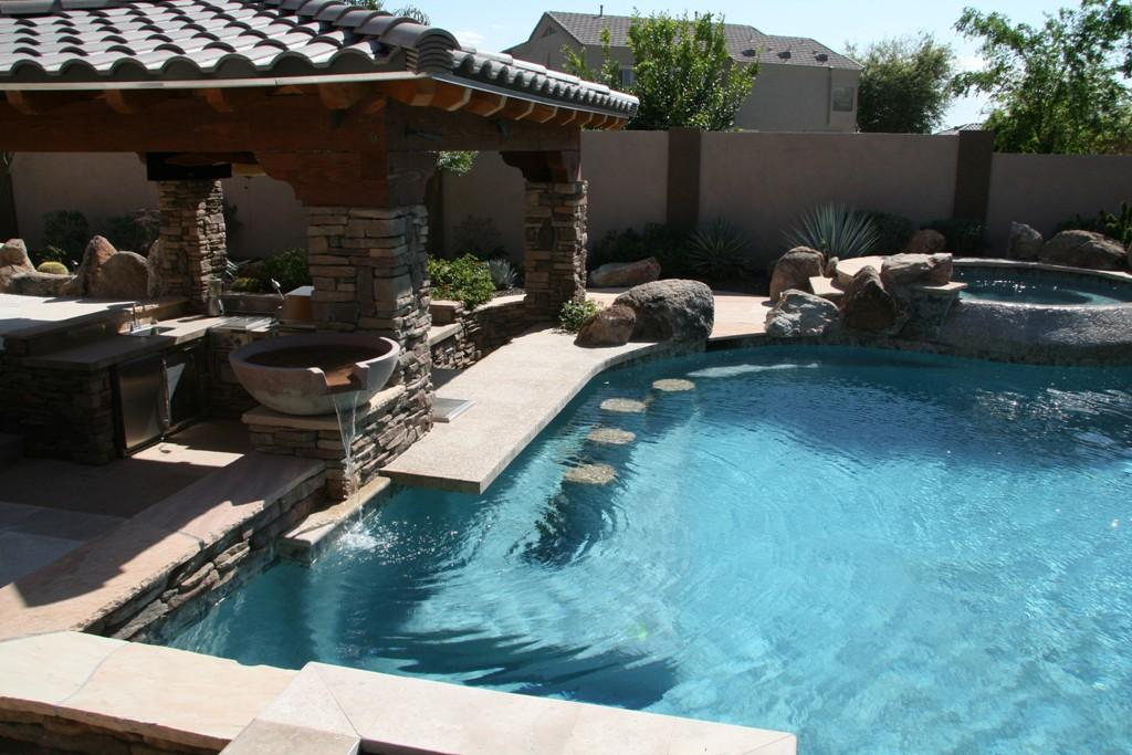 Swim up pool bars on pinterest swim up bar pool bar and outdoor kitchens - Backyard swimming pools designs ...