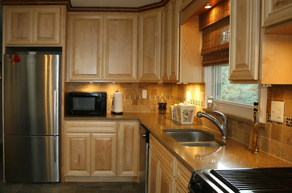 Kitchen cabinets natural maple and quartzite counter top