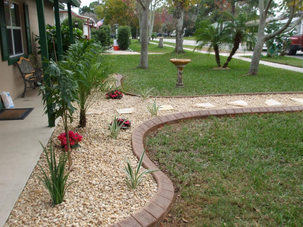Landscape curbing from curb appeal hardscaping llc in for Landscaping rocks daytona beach