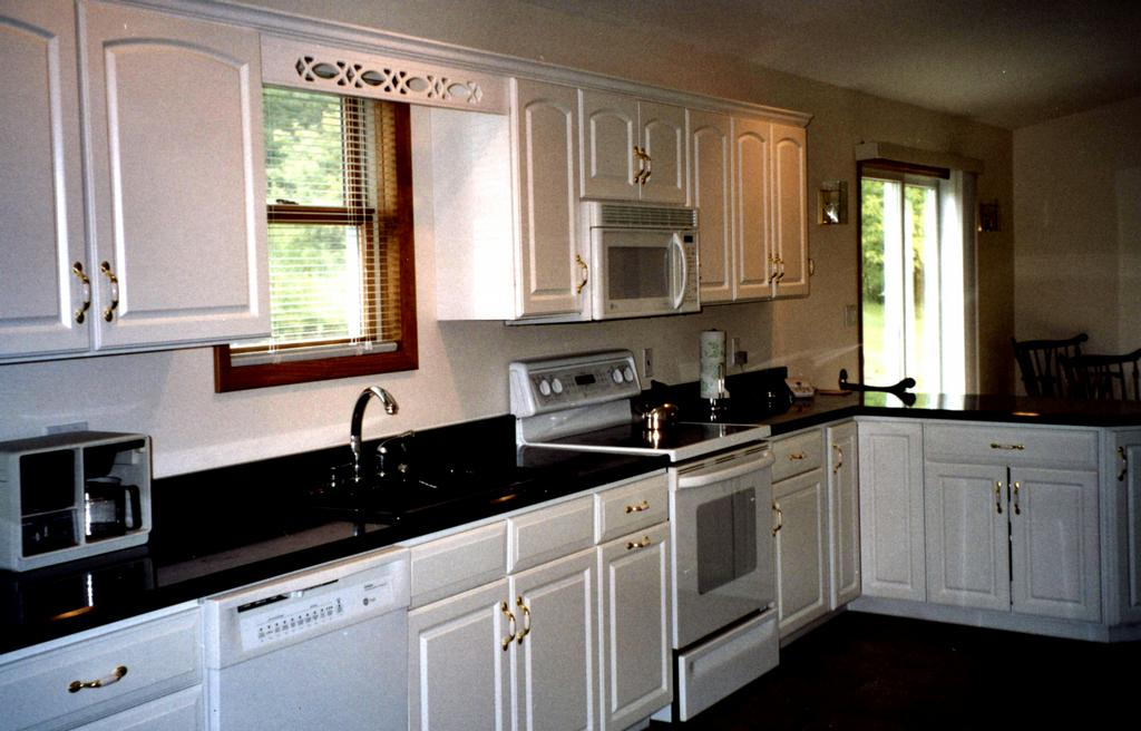 white foil cabinets with black granite from catskill