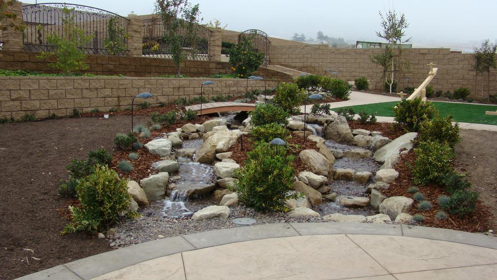 Waterfall and Stream backyard design by Landscape Designs by Lloyd ...