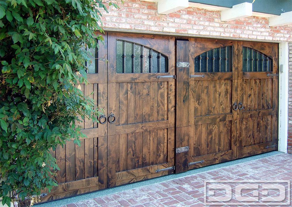 Rustic mediterranean garage doors in solid alder wood w for Mediterranean garage doors