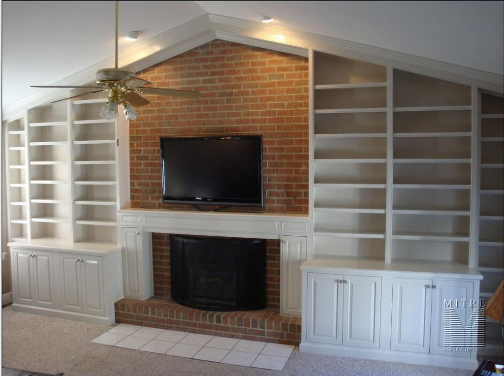 cathedral ceiling recessed lighting ideas - Custom Built In Bookcases & Mantel from MITRE CONTRACTING