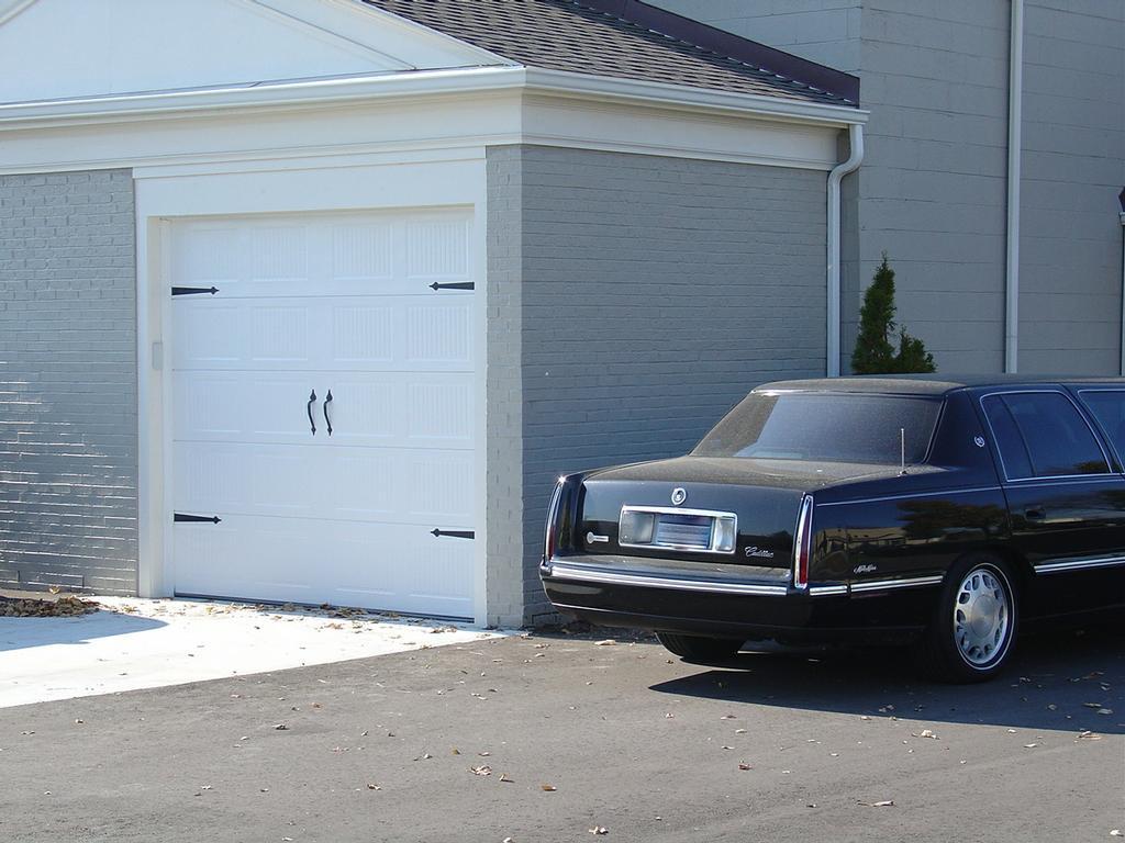 Door doctor services inc milford mi 48381 248 437 5163 for Garage door repair berkley mi
