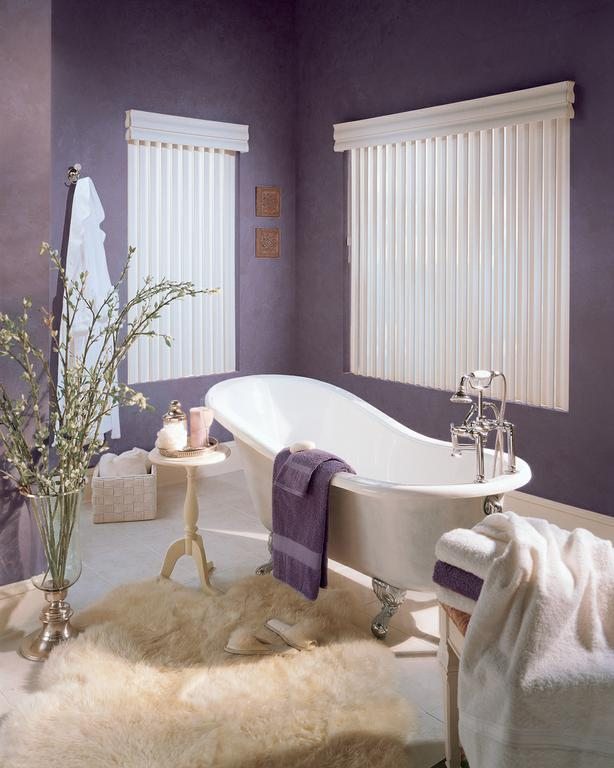 Purple bathroom with hints of cream and a white bathtub