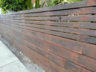 Green building with reclaimed wood harwell fencing for Los angeles reclaimed wood