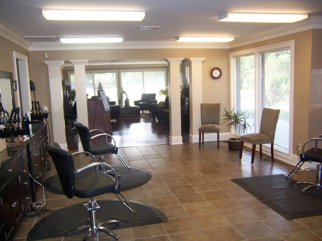 Front open salon looking into waiting area from trilogy for Hair salons open near me