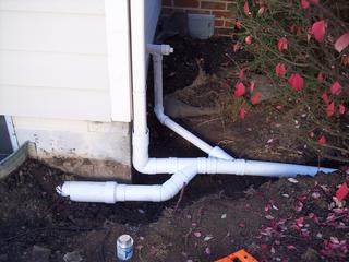 BASEMENT WATERPROOFING, DOWNSPOUT DRAIN TILE, DOOR/DRIVEWAY DRAINAGE, SUMP PUMPS