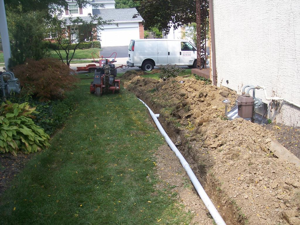 plumb 1 by Rain Drain Columbus Ohio Basement Waterproofing Gutter Protection Yard Drain Systems Foundation