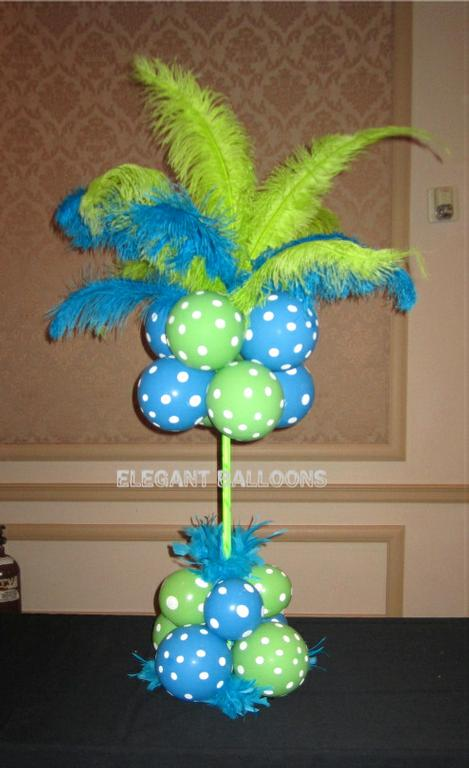 Ostrich feather centerpiece with balloons from elegant