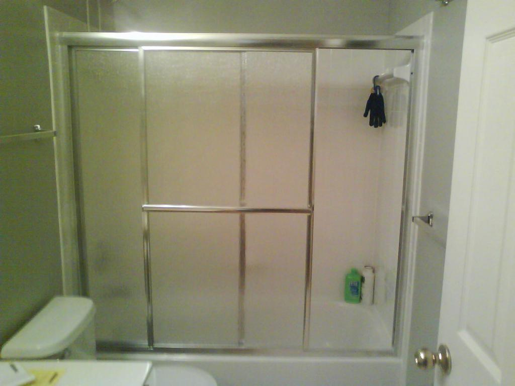 After bath tub sliding door installed from mr handyman of for Sliding glass doors tub
