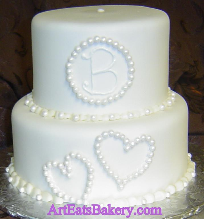 Unique Anniversary Cake Design : Two tier white fondant anniversary cake with unique custom ...