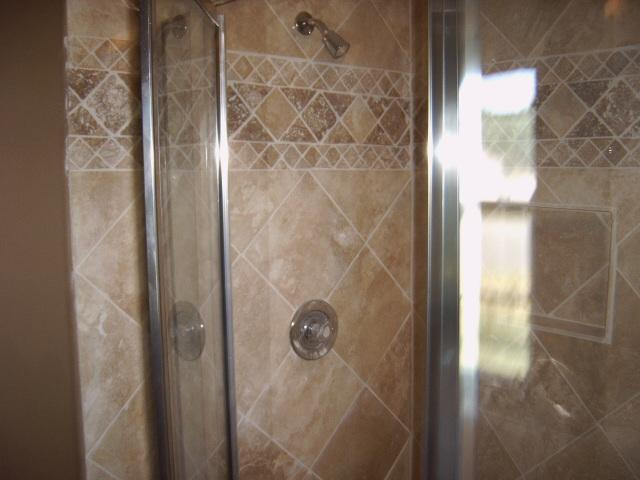 tile shower from nbcr custom renovations in central