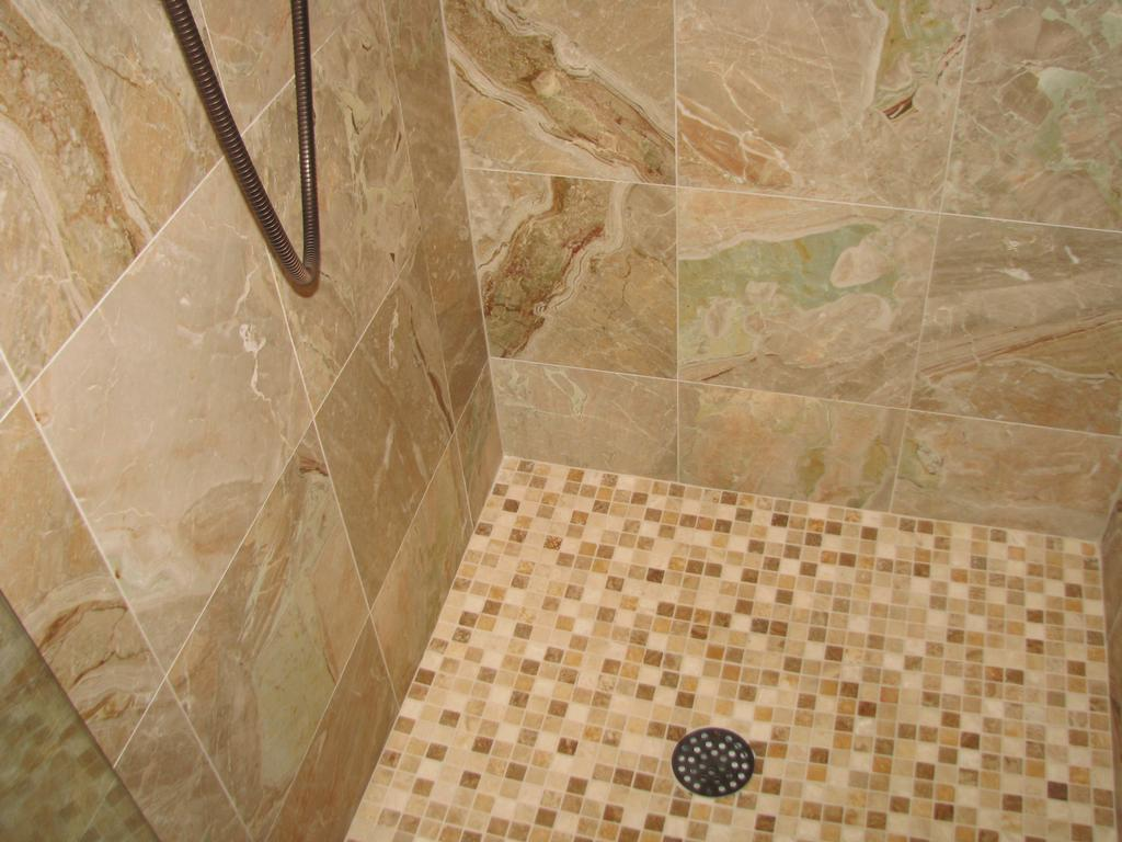 Natural Stone Showers http://www.merchantcircle.com/business/Designer.Homes.Construction.Inc..561-214-4415/picture/view/2457483