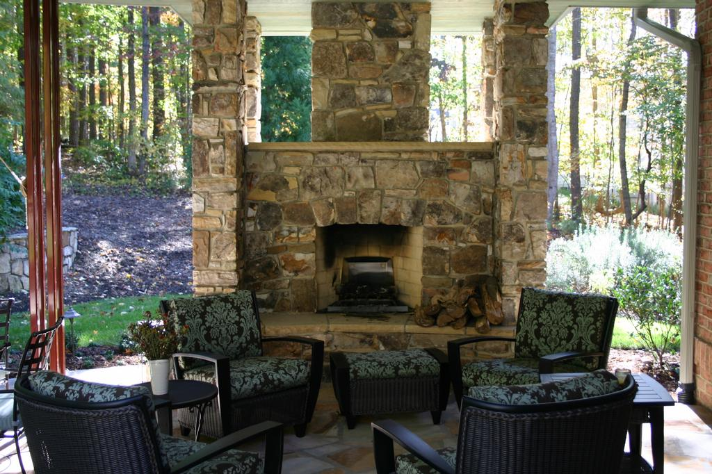Outdoor Covered Patio With Fireplace From Stone Center Of