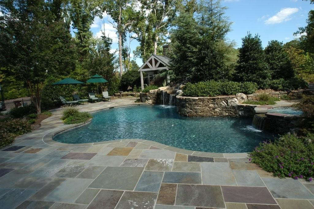 The best natural stone materials to use on a pool deck Flagstone pavers around pool