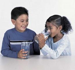 kids drinking water from glasses