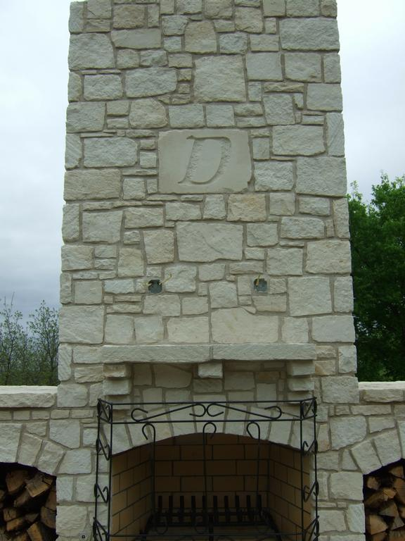 Pictures for rock solid materials llc in bixby ok 74008 for Austin stone fireplace