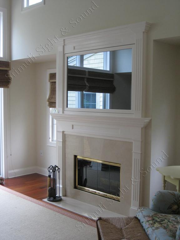 Seura television mirror over fireplace from stimuli sight for Tlvision miroir