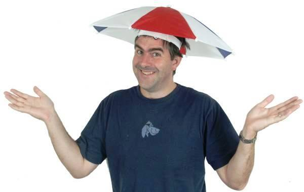 smiling guy in tshirt with umbrella hat red.4web by GILES COMMERCIAL REALTY GROUP