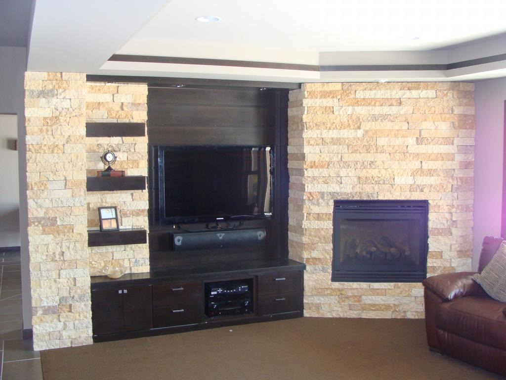 Limestone Fireplace Column Bookshelves From Mud Brothers Stone Masonry Inc In Mankato Mn 56001