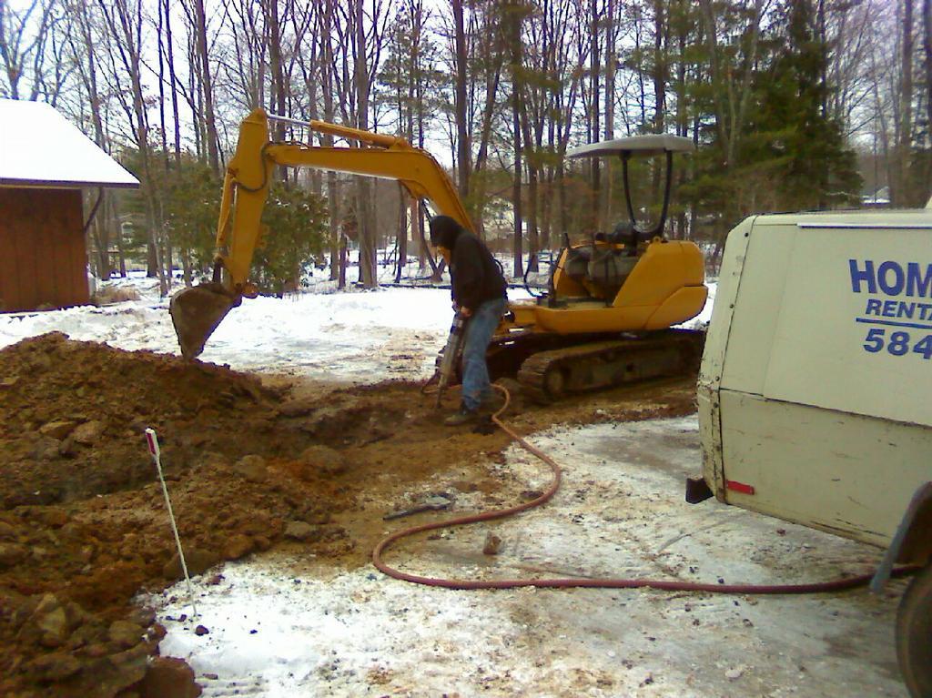 killiher jack hammering.jpg by Excavating NJ Inc.