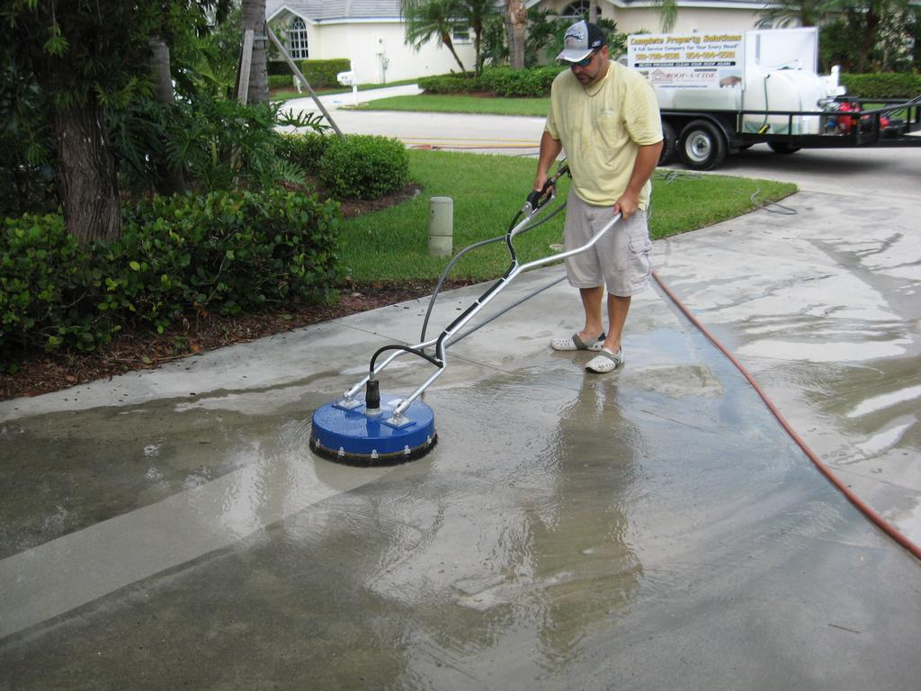 Driveway cleaning from complete property solutions in west for Best solution to clean concrete driveway