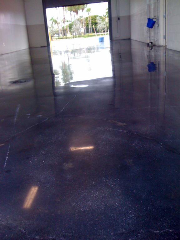 Black polishing concrete floors from outstanding floors for Buffing stained concrete floors