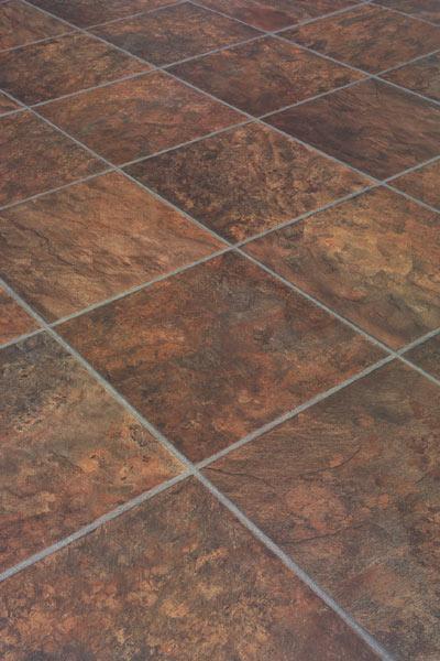 Laminate flooring laminate flooring looks like stone tile for Laminate tile flooring