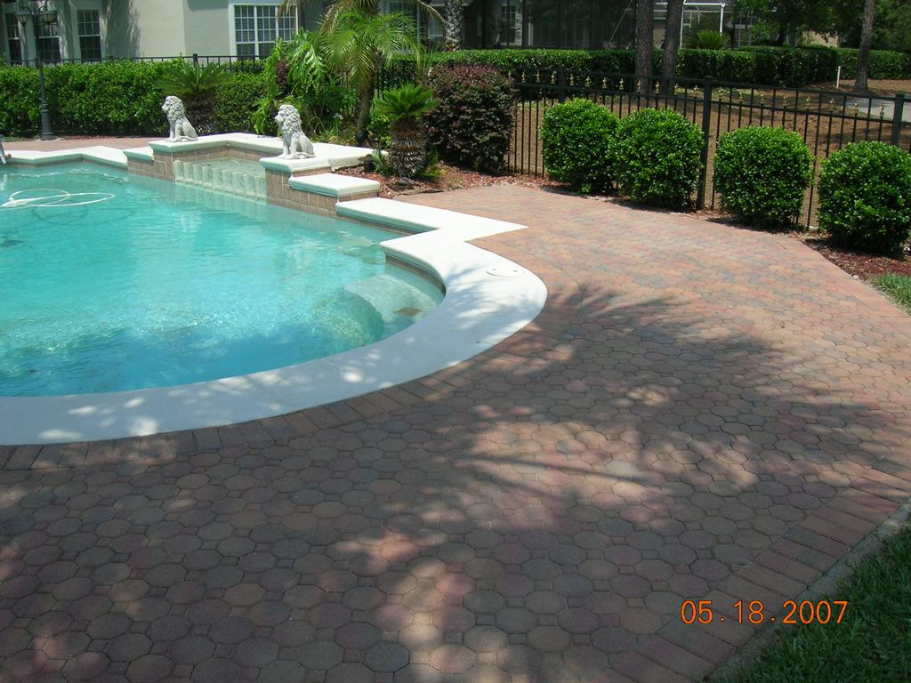 Beautiful pool deck from florida surface solutions inc for Florida pool and deck