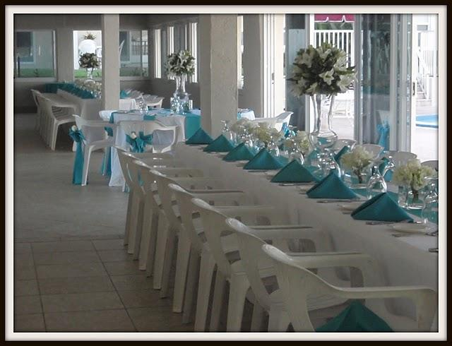 Tags white turquoise linens centerpieces hydrangeas lilies roses glass