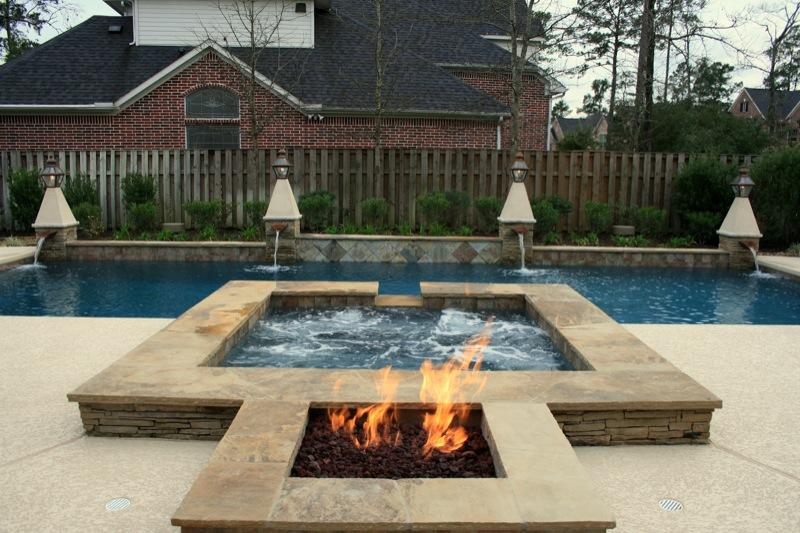 Fire and water elegence from outdoor amenities pool co in for Pool with fireplace