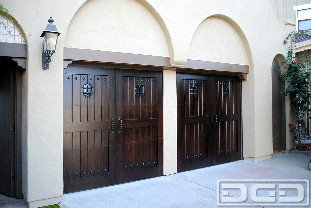 Spanish mediterranean style garage doors custom made in for Wood veneer garage doors