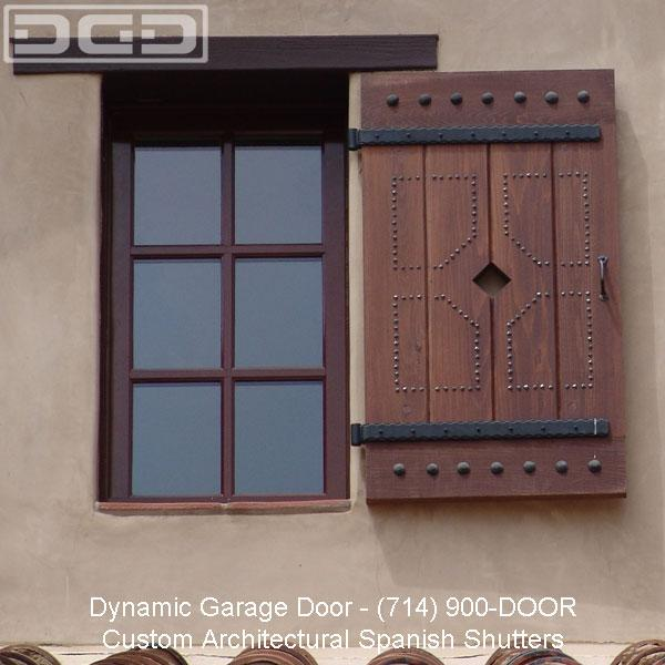 Custom spanish shutters with decorative iron hardware by for Spanish style window shutters
