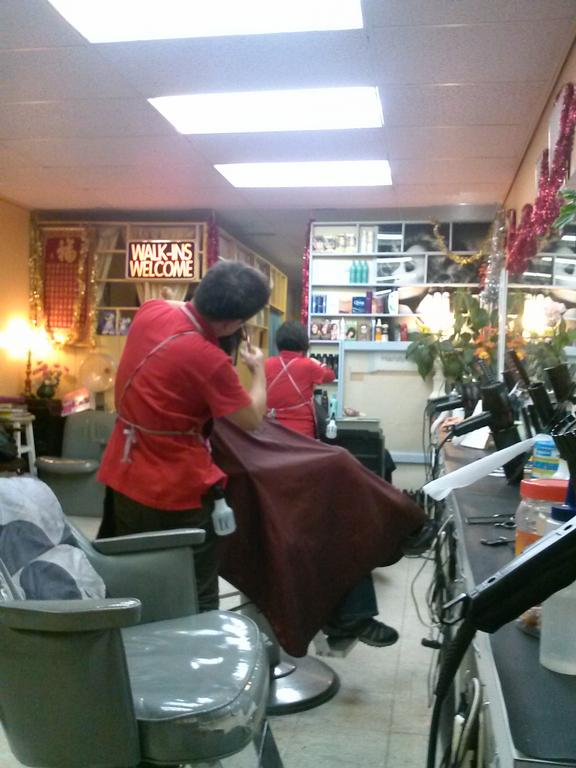 Barber Quincy : Snip snip, busy cutting your hair beautifully! by Charlie Hair Salon