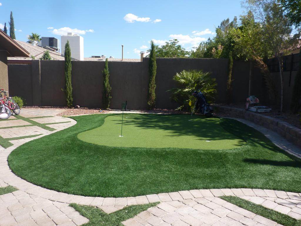 Pictures for desert greenscapes water wise grass and for Las vegas stone yards